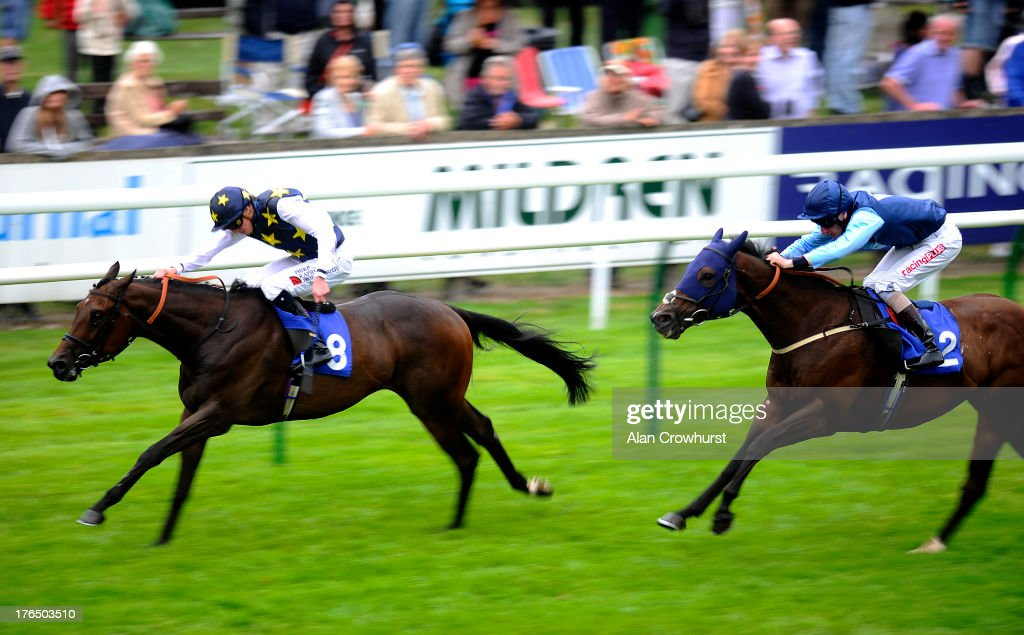 James Doyle riding Lisa's Legacy to win The Champagne Joseph Perrier Handicap Stakes at Salisbury racecourse on August 14, 2013 in Salisbury, England.