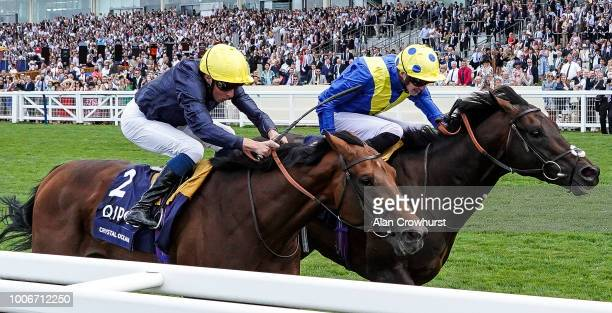 James Doyle riding Poets Word win The King George VI And Queen Elizabeth Stakes from Crystal Ocean and William Buick at Ascot Racecourse on July 28...