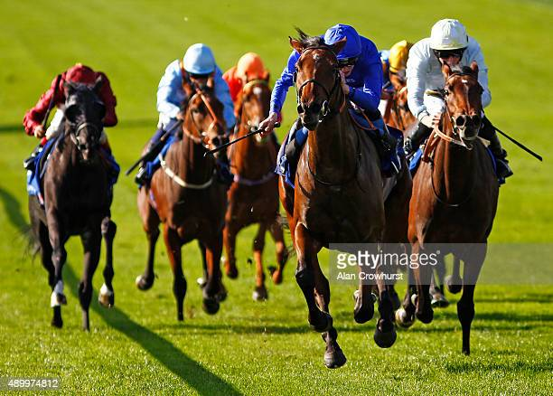 James Doyle riding Promising Run win The Shadwell Rockfel Stakes at Newmarket racecourse on September 25 2015 in Newmarket England