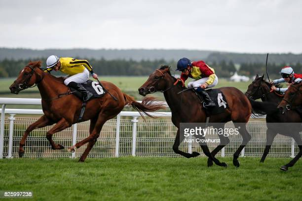 James Doyle riding Roulette win The Victoria Racing Club EBF British Stallion Studs Maiden Filliesâ Stakes on day three of the Qatar Goodwood...