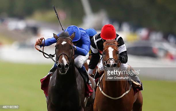 James Doyle riding Toormore win The Qatar Lennox Stakes at Goodwood racecourse on July 28 2015 in Chichester England