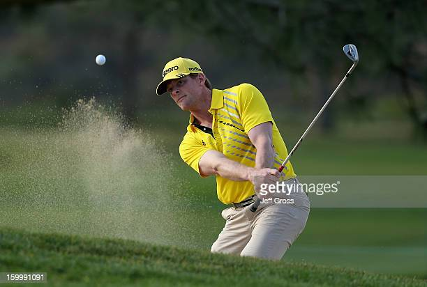 James Driscoll hits a bunker shot to the ninth green during the first round of the Farmers Insurance Open at Torrey Pines North Course on January 24...