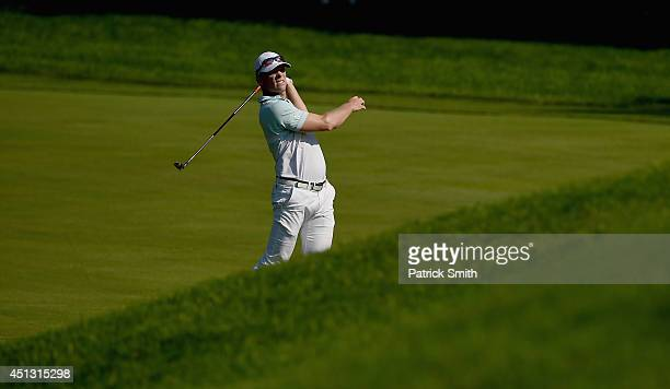 James Driscoll of the United States watches his approach shot on the ninth hole during the second round of the Quicken Loans National at...