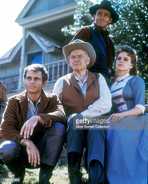 James Drury US actor Charles Bickford US actor Don Quine US actor and Sara Lane US actress pose for a group portrait all in Western costume in a...