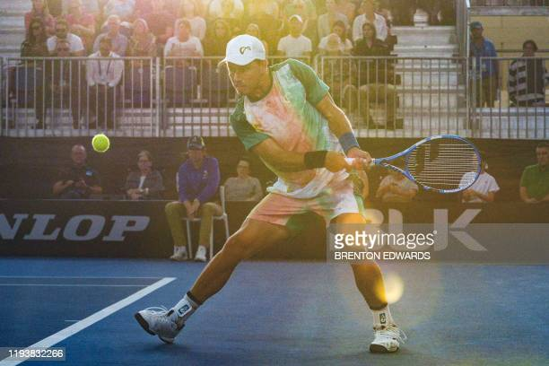 James Duckworth of Australia hits a return to Felix AugerAliassime of Canada during their men's second round singles match at the Adelaide...