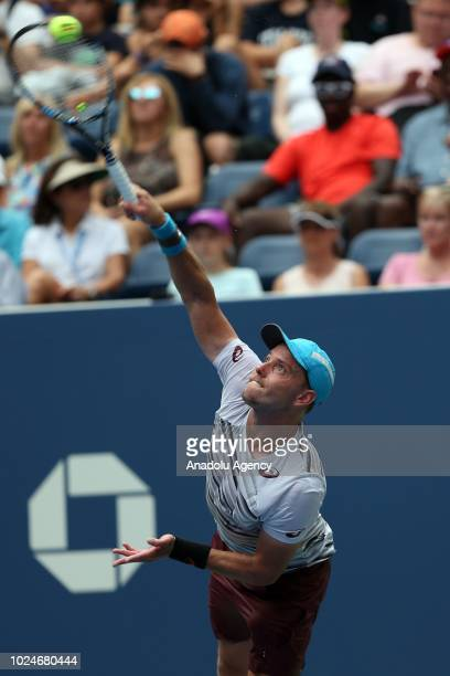 James Duckworth of Australia in action against British tennis player Andy Murray during US Open tennis tournament match at the Louis Armstrong...