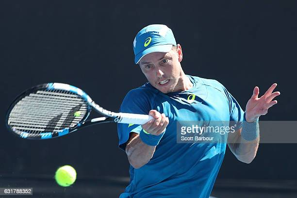 James Duckworth of Australia plays a forehand in his first round match against Paolo Lorenzi of Italy on day one of the 2017 Australian Open at...