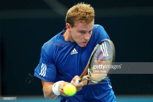 James Duckworth of Australia plays a shot during his match against Gilles Simon of France during day four of the 2012 Brisbane International at Pat...