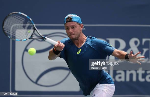 James Duckworth of Australia returns a forehand to Ryan Harrison during the BBT Atlanta Open at Atlantic Station on July 24 2018 in Atlanta Georgia