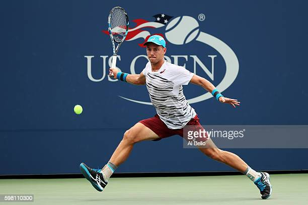 James Duckworth of Australia returns a shot to JoWilfried Tsonga of France during his second round Men's Singles match on Day Three of the 2016 US...