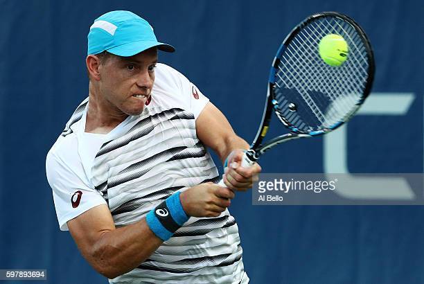 James Duckworth of Australia returns a shot to Robin Haase of the Netherlands during his first round Men's Singles match on Day One of the 2016 US...
