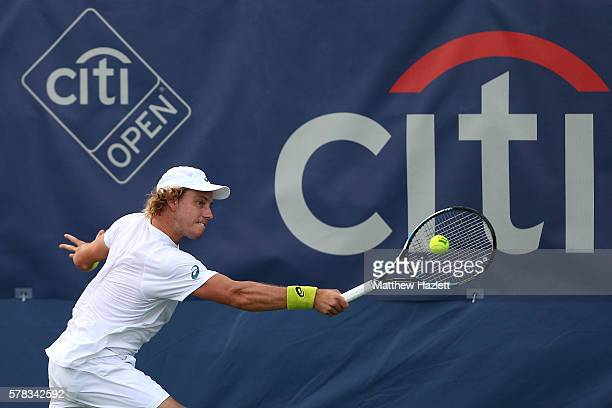 James Duckworth of Australia returns a shot to Tim Smyczek of the United States of America during day 1 of the Citi Open at Rock Creek Tennis Center...