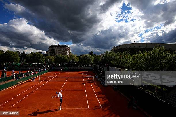 James Duckworth of Australia serves during his men's singles qualifying match against Blaz Kavcic of Slovenia during previews ahead of the French...