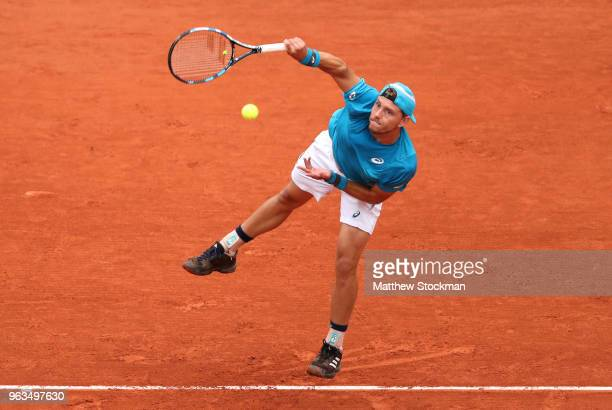 James Duckworth of Australia serves during the mens singles first round match against Marin Cilic of Croatia during day three of the 2018 French Open...