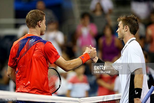 James Duckworth of Australia shakes hands at the net with Tim Smyczek of the United States after their men's singles first round match on Day Three...