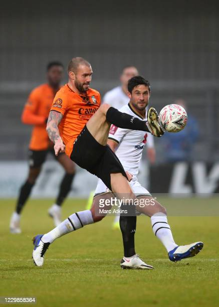 James Dunne of Barnet in action with Andrew Surman of MK Dons during the Emirates FA Cup Second Round match between Barnet FC and Milton Keynes Dons...
