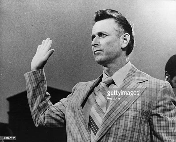 James Earl Ray the convicted killer of Civil Rights leader Martin Luther King taking the oath before a committee in Washington where he denied he...