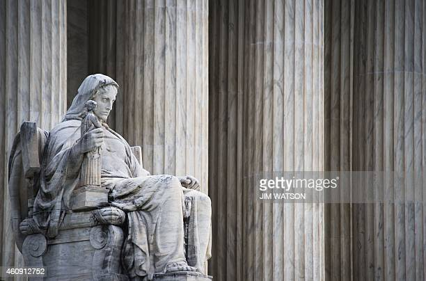 James Earle Frasers statue of the Contemplation of Justice stands in front of the US Supreme Court in Washington DC December 30 2014 AFP PHOTO/JIM...