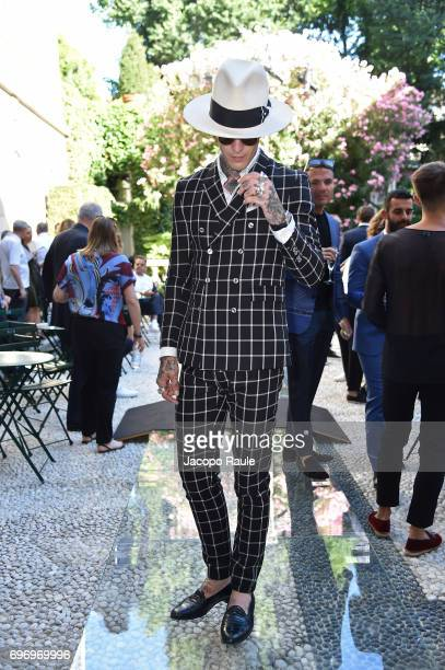 James Edward Quaintance attends the Versace show during Milan Men's Fashion Week Spring/Summer 2018 on June 17 2017 in Milan Italy