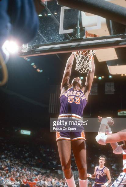 James Edwards of the Phoenix Suns slam dunks the ball against the Washington Bullets during an NBA basketball game circa 1985 at the Capital Centre...