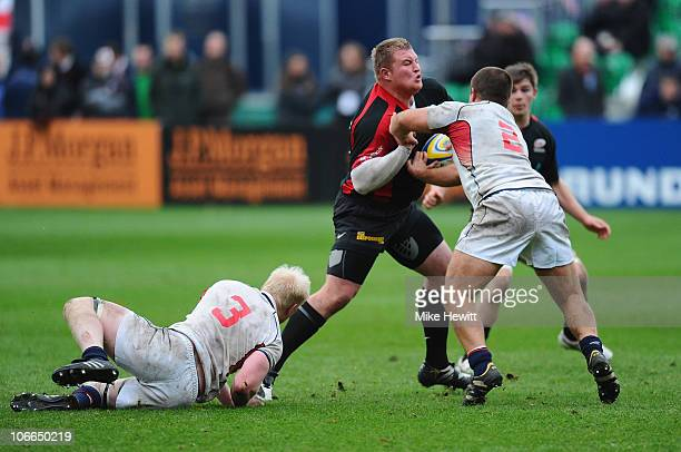James Ellershaw of Saracens is stopped by Eric Fry and Chris Biller of USA during the friendly match between Saracens and USA at the Honourable...