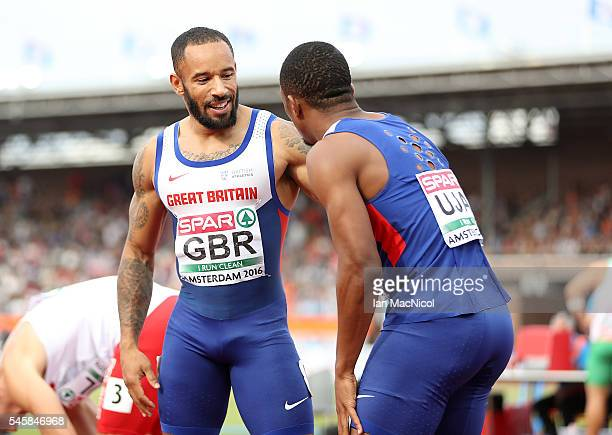 James Ellington of Great Britain celebrates with team mate Chijindu Ujah after winning gold in the final of the mens 4x100m relay on day five of The...