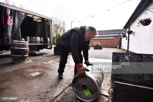 James Ellis employee of Joules Brewery, delivers beer at the White Horse Pub on April 06, 2021 in Shrewsbury, England. Joules Brewery is a small...