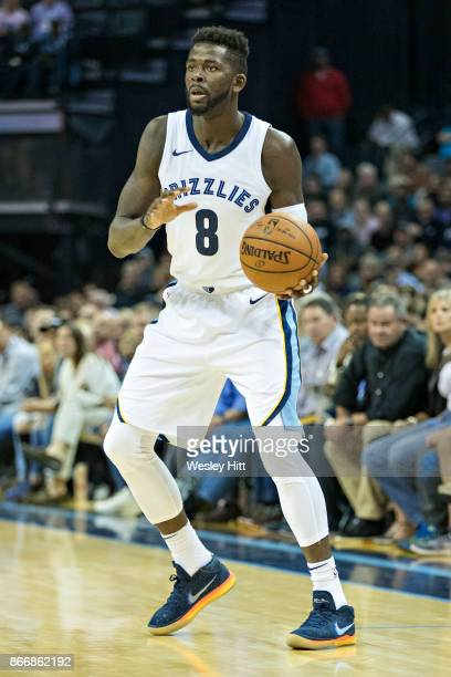James Ennis III of the Memphis Grizzlies looks to make a pass during a game against the Dallas Mavericks at the FedEx Forum on October 26 2017 in...