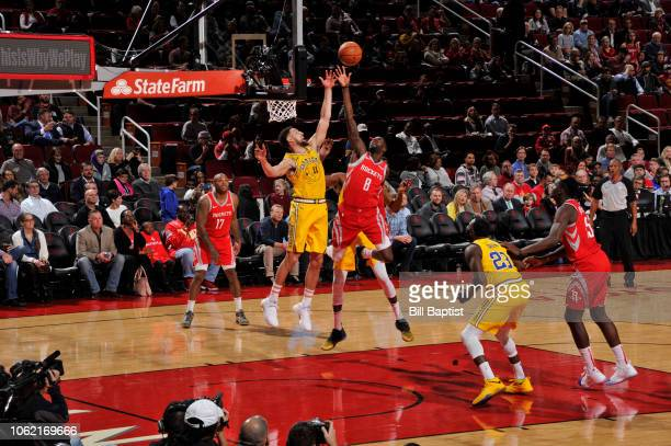 James Ennis of the Houston Rockets shoots the ball against Play Thompson the Golden State Warriors on November 15 2018 at the Toyota Center in...