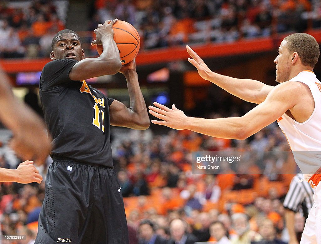 James Ennis #11 of the Long Beach State 49ers holds the ball against Brandon Triche #20 of the Syracuse Orange during the game at the Carrier Dome on December 6, 2012 in Syracuse, New York.