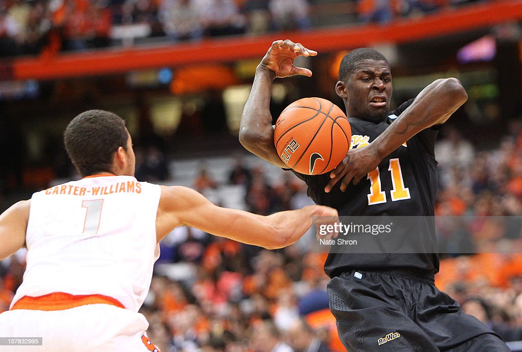 James Ennis #11 of the Long Beach State 49ers struggles to hold on to the ball against Michael Carter-Williams #1 of the Syracuse Orange during the game at the Carrier Dome on December 6, 2012 in Syracuse, New York.