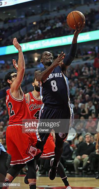 James Ennis of the Memphis Grizzlies goes up for a shot past Kirk Hinrich of the Chicago Bulls at the United Center on December 16 2015 in Chicago...