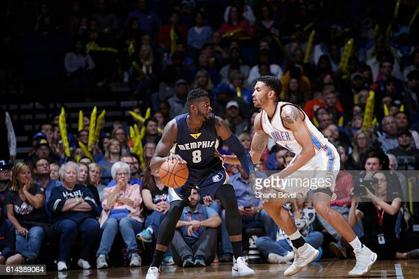 James Ennis of the Memphis Grizzlies handles the ball against Josh Huestis of the Oklahoma City Thunder during a preseason game on October 13 2016 at...