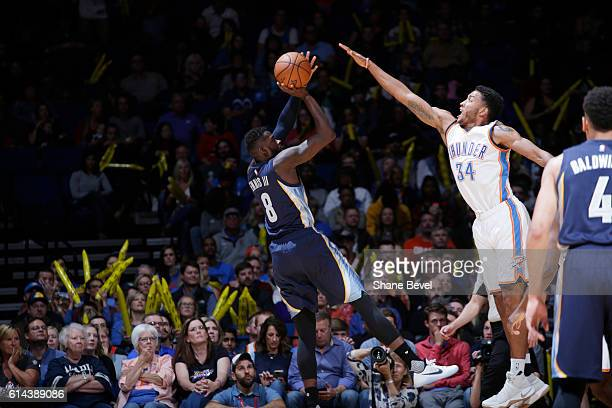 James Ennis of the Memphis Grizzlies shoots the ball against Josh Huestis of the Oklahoma City Thunder during a preseason game on October 13 2016 at...