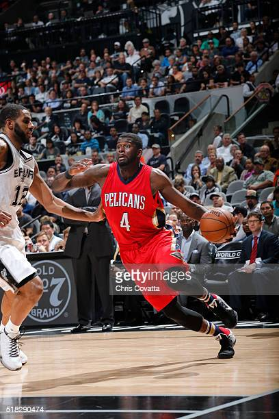 James Ennis of the New Orleans Pelicans drives to the basket against the San Antonio Spurs during the game on March 30 2016 at ATT Center in San...