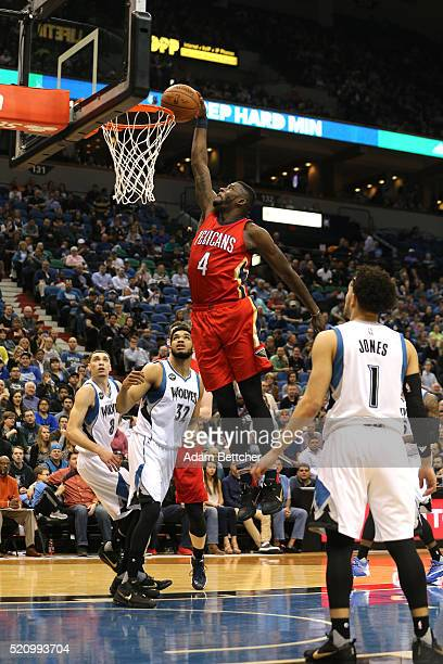 James Ennis of the New Orleans Pelicans dunks the ball in the first half against the Minnesota Timberwolves on April 13 2016 at Target Center in...