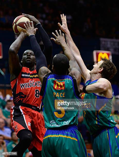 James Ennis of the Wildcats attempts a jump shot over Joshua Pace and Peter Crawford of the Crocodiles during the round 17 NBL match between the...
