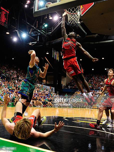 James Ennis of the Wildcats attempts to regather the ball with Brian Conklin of the Crocodiles during the round 13 NBL match between the Townsville...