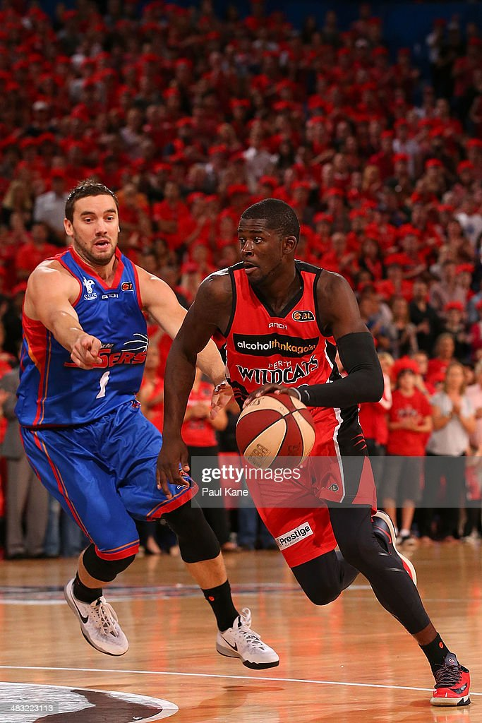 James Ennis of the Wildcats drives to towards the keyway against Adam Gibson of the 36ers during game one of the NBL Grand Final series between the Perth Wildcats and the Adelaide 36ers at Perth Arena on April 7, 2014 in Perth, Australia.