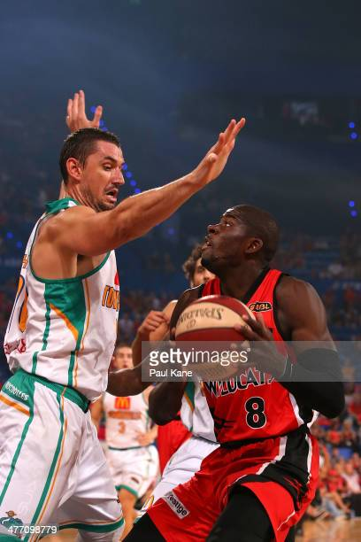 James Ennis of the Wildcats looks to shoot against Russell Hinder of the Crocodiles during the round 21 NBL match between the Perth Wildcats and the...