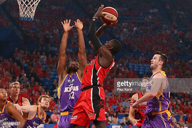 James Ennis of the Wildcats shoots the ball against Sam Young of the Kings during the round seven NBL match between the Perth Wildcats and the Sydney...