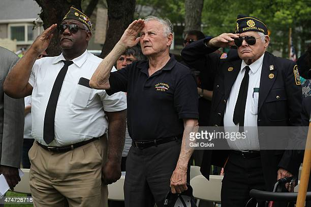 BEDFORD MA MAY 25 James F Comley salutes the raising of the American flag during the Bedford Memorial Day Parade on May 25 2015 in Bedford...