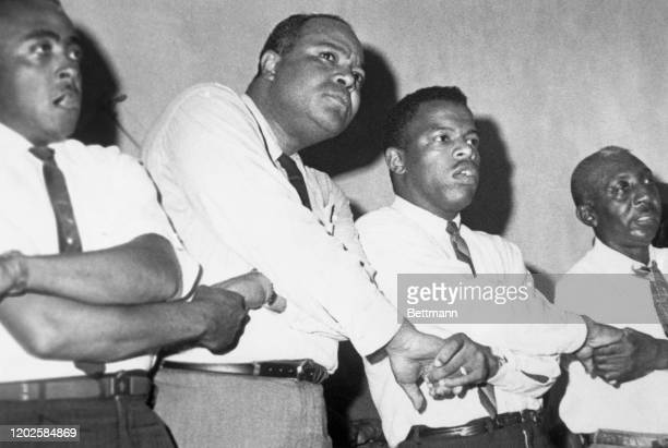 James Farmer and John Lewis join hands and sing after a civil rights meeting The civil rights leaders spoke to the crowd termed by one of the...