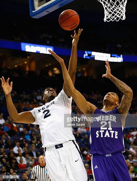James Farr of the Xavier Musketeers battles for the ball with Joel Bolomboy of the Weber State Wildcats in the first half of their game during the...