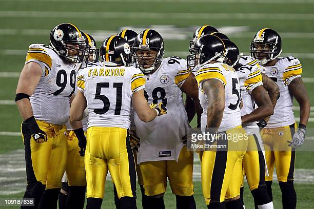 James Farrior of the Pittsburgh Steelers calls a play in the defensive huddle as Brett Keisel and Casey Hampton look on against the Green Bay Packers...