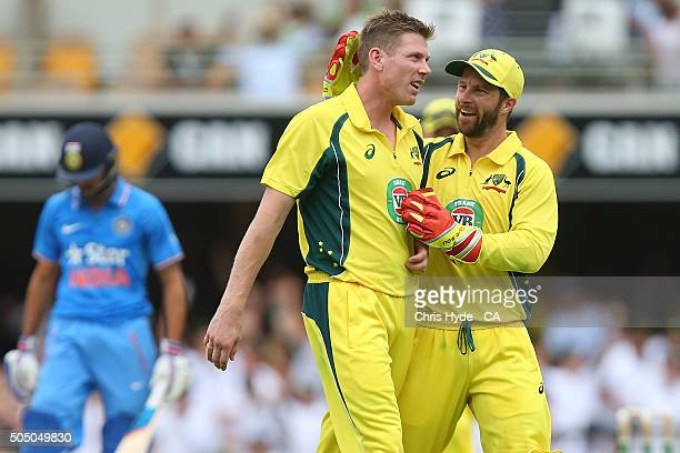 James Faulkner of Australia celebrates dismissing Ajinkya Rahane of India during game two of the Victoria Bitter One Day International Series between...