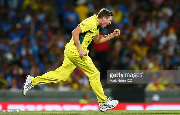 James Faulkner of Australia celebrates getting the wicket of Suresh Raina of India during the 2015 Cricket World Cup Semi Final match between...