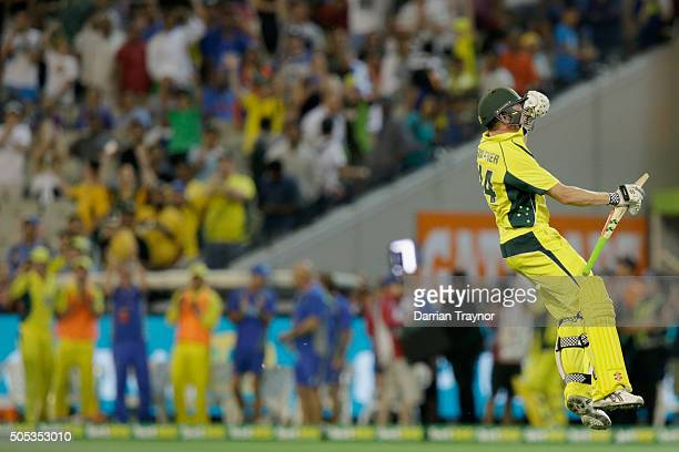James Faulkner of Australia celebrates hitting the winning runs as his team mates look on from the boundary line during game three of the One Day...
