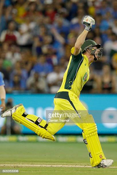 James Faulkner of Australia celebrates hitting the winning runs during game three of the One Day International Series between Australia and India at...