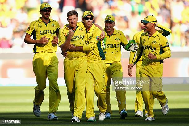 James Faulkner of Australia celebrates with team mates after dismissing Corey Anderson of New Zealand during the 2015 ICC Cricket World Cup final...